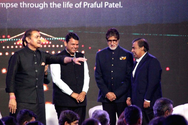 NCP leader Praful Patel, Maharashtra Chief Minister Devendra Fadnavis, actor Amitabh Bachchan, and business man, Mukesh Ambani during the launch of Nationalist Congress Party (NCP) leader ... - Devendra Fadnavis, Praful Patel, Amitabh Bachchan and Mukesh Ambani