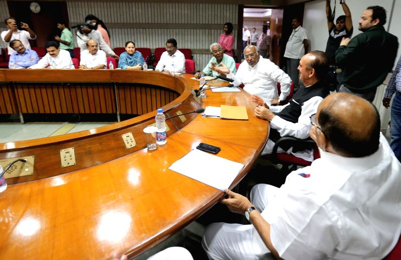 NCP leader Sharad Pawar, Congress leaders Ghulam Nabi Azad and Mallikarjun Kharge, CPI leader D Raja, RJD leader Misa Bharti and other leaders during a meeting of opposition parties to ...