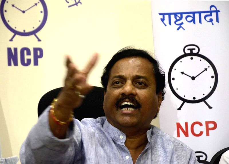 : NCP leader Sunil Tatkare addresses a press conference in Mumbai, on Sept. 29, 2014. .