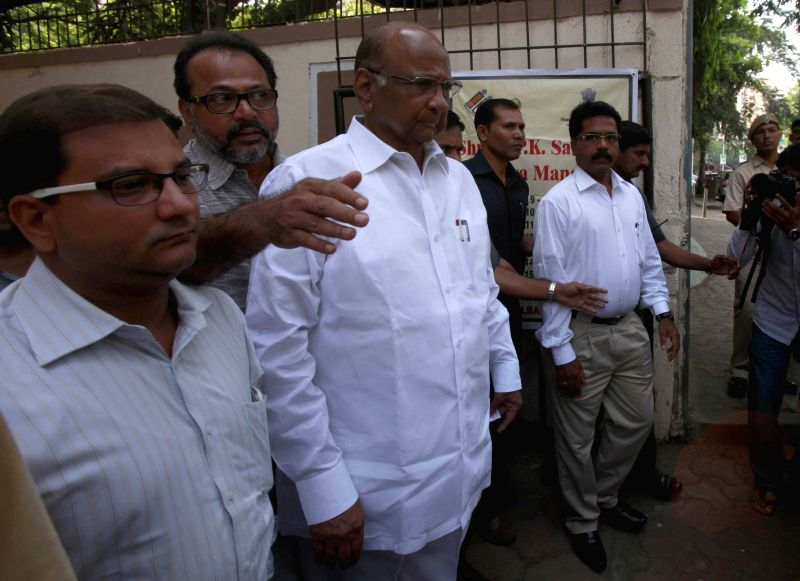 NCP president Sharad Pawar at a polling booth to cast his vote in Mumbai on April 24, 2014.