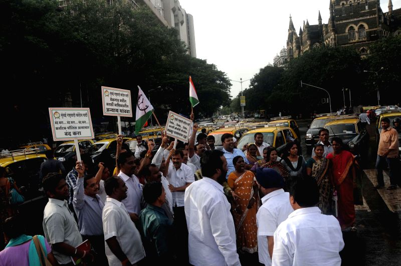 NCP workers stage a demonstration at Hutatma Chowk of Mumbai on on Aug 5, 2014.
