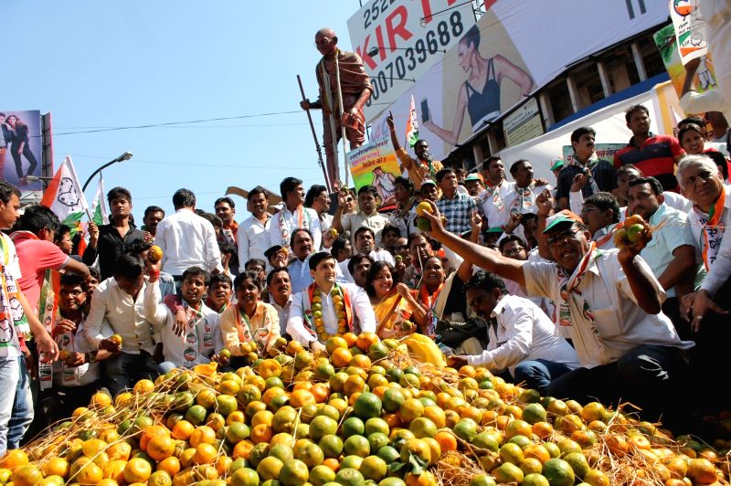 NCP workers stage a demonstration to press for better prices for oranges in Nagpur, on Dec 7, 2015.