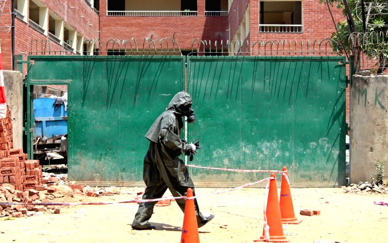 NDRF officials investigating the gas leak near a school in Delhi on May 6, 2017.