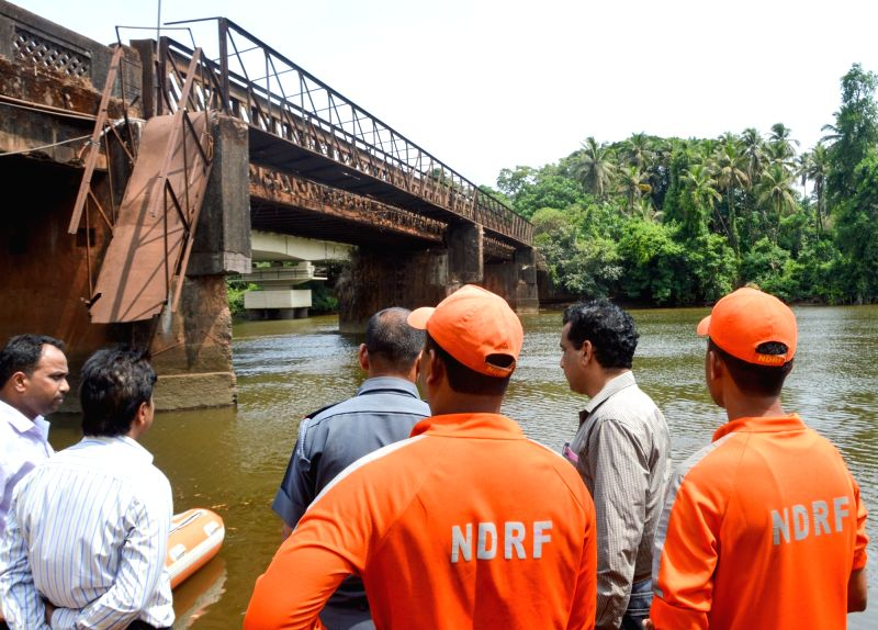 NDRF personnel involved in search and rescue operations after a dilapidated foot bridge collapsed into a Sanvordem river in Curchorem village, 45 km from  Panaji on May 19, 2017. Two ...