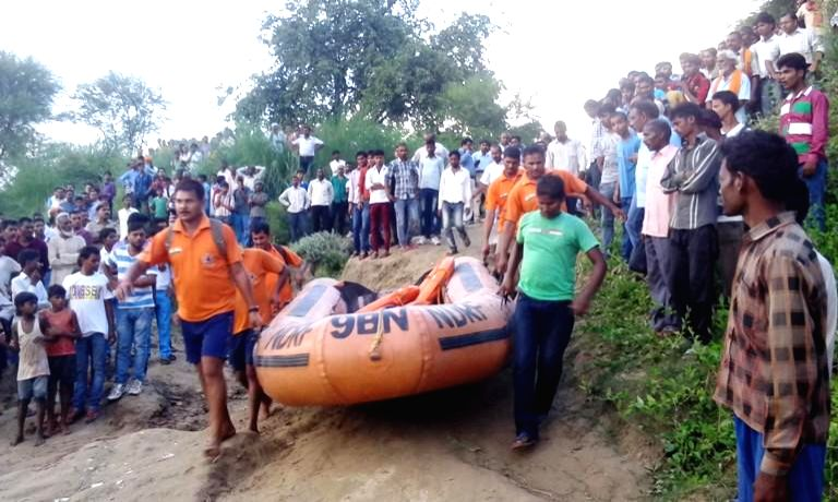 NDRF personnel prepare for rescue work after a boat capsizes in the Ganga river in Mirzapur district on Aug. 5, 2014.
