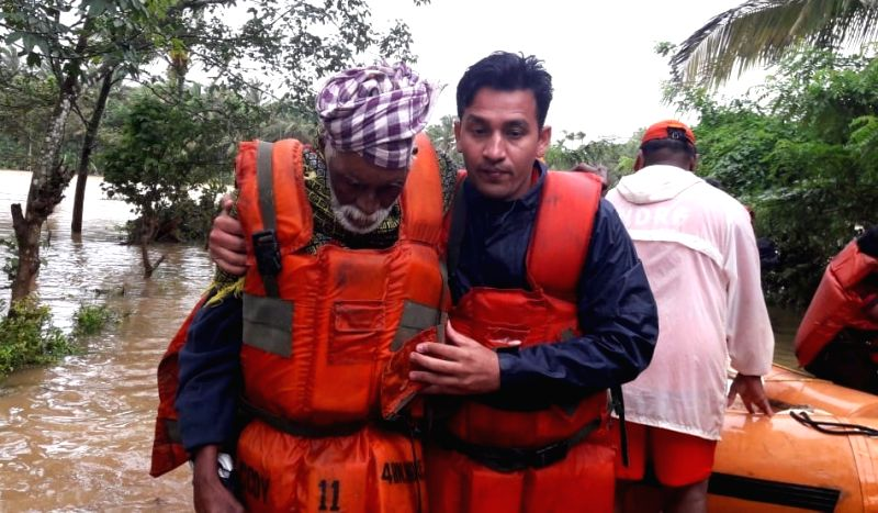 NDRF teams carrying out rescue and relief operations in flood-affected areas of Kerala on Aug 11, 2018.