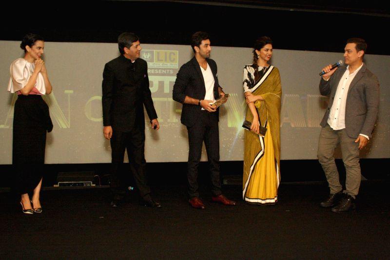 NDTV Group CEO Vikram Chandra with actors Aamir Khan, Ranbir Kapoor, Deepika Padukone and Kangana Ranaut during NDTV Indian of the Year Awards function in New Delhi on April 29, 2014. - Aamir Khan, Ranbir Kapoor, Deepika Padukone and Kangana Ranaut