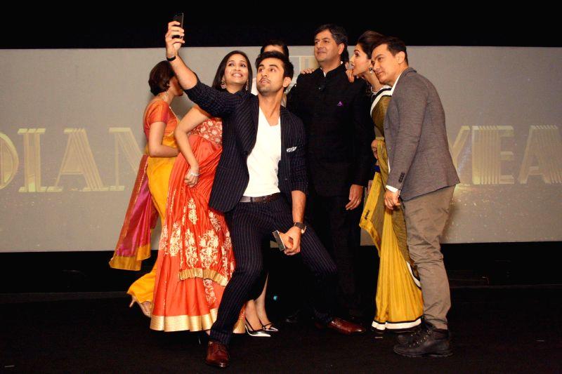 NDTV Group CEO Vikram Chandra with actors Aamir Khan, Ranbir Kapoor, Deepika Padukone and filmmaker Soundarya Rajinikanth during NDTV Indian of the Year Awards function in New Delhi on April 29, ... - Aamir Khan, Ranbir Kapoor and Deepika Padukone