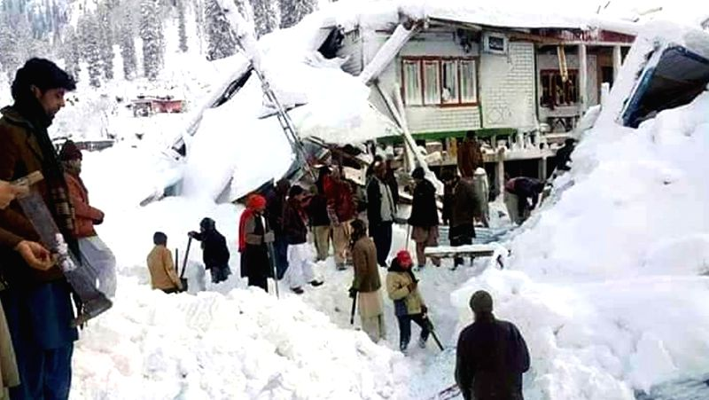 NEELUM VALLEY, Jan. 16, 2020 (Xinhua) -- Photo taken on Jan. 14, 2020 by a mobile phone shows local residents gathering near houses hit by an avalanche in Neelum Valley in Pakistan-controlled Kashmir. Death toll of multiple avalanches in Pakistan-con