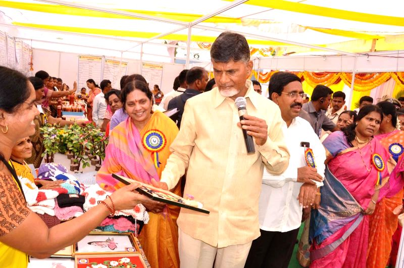 Andhra Chief Minister N. Chandrababu Naidu participates in a programme organised on the International Women's Day in Kanupathipadu of Andhra Pradesh's Nellore district on March 8, 2015. - N. Chandrababu Naidu