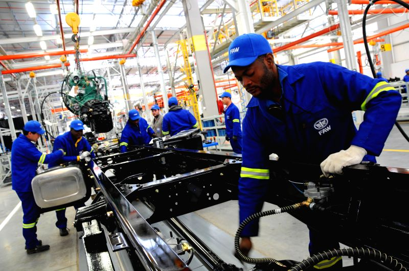 Workers work in new assembly production plant of China First Automotive Works (FAW) Group Corporation in Nelson Mandela Bay Municipality, South Africa, July .