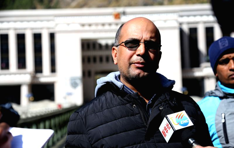 Nepal Oil Corporation(NOC) spokesperson Deepak Baral talks about the procedure of receiving petrol provided by the Chinese government in Rasuwa, Nepal, Oct. 31, ...