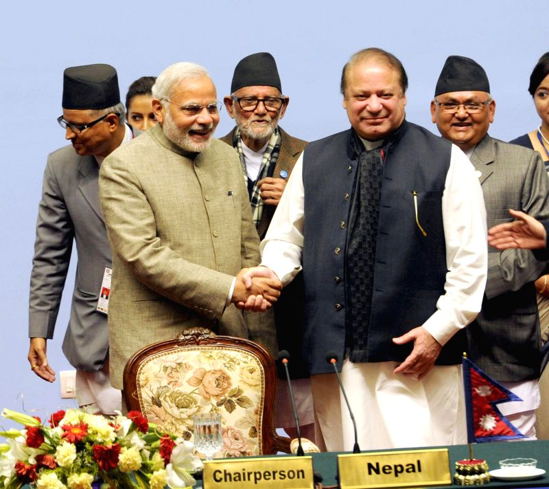 Prime Minister Narendra Modi shakes hands with Prime Minister of Pakistan, Nawaz Sharif at the 18th SAARC Summit, in Nepal on Nov 27, 2014. Also seen Prime Minister of Nepal Sushil Koirala. - Narendra Modi