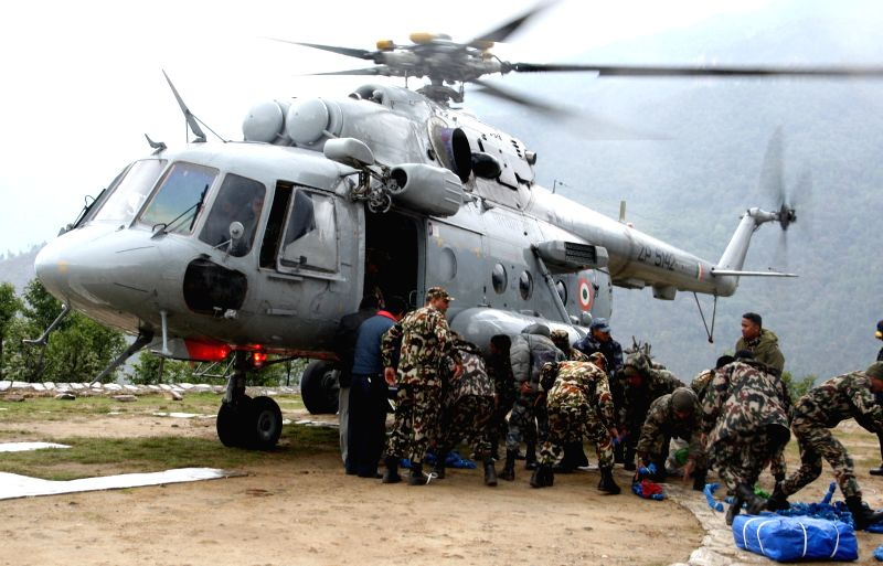 Relief materials being unloaded from a Indian Air Force's Mi-17 chopper  in quake-hit  Nepal.