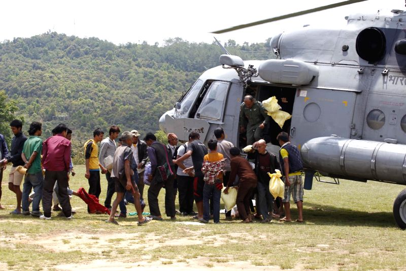 Stranded persons to be taken to a safer place, queuing up for boarding an Indian Air Force (IAF) helicopter yesterday following a recent massive earthquake in in Nepal.