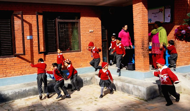 Nepalese children run out of their class in a local school after a 5.3-magnitude earthquake in Kathmandu, Nepal, Nov. 19, 2015.