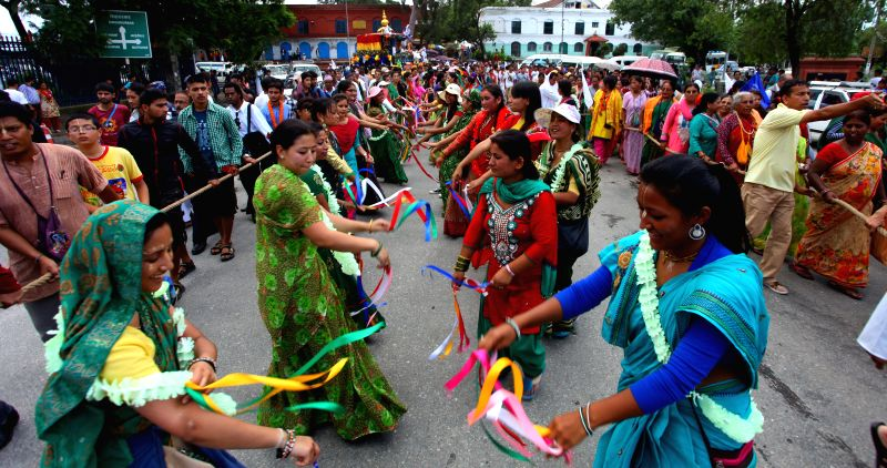 Nepalese devotees dance during annual Rath Yatra, or Festival of Chariot in Kathmandu, Nepal, July 18, 2015.
