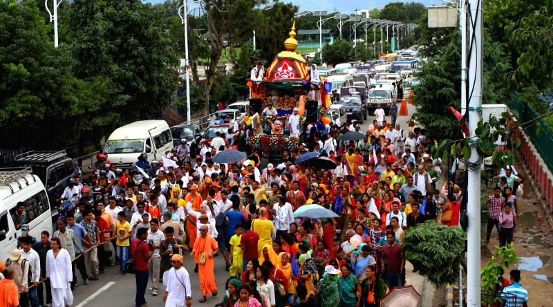 Nepalese devotees participate in the pulling of the chariot of Lord Jagannath during annual Rath Yatra, or Festival of Chariot in Kathmandu, Nepal, July 18, 2015. ...