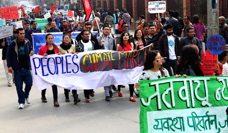 Nepalese people participate in a rally for the People's Climate March to show solidarity towards the contemporary climate issues of the planet earth in Kathmandu, ...