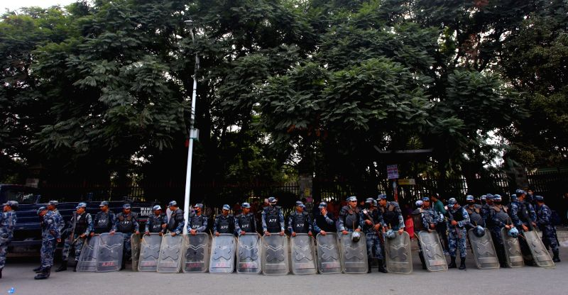 Nepalese police personnel guard during a protest rally to pressurize the government to lift the blockade in Kathmandu, Nepal, Nov. 24, 2015. The protest rally was ...