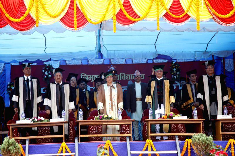 Nepalese President Bidhya Devi Bhandari (C, front) attends the 41st convocation ceremony of Tribhuvan University at Dashrath Stadium in Kathmandu, Nepal, Dec. 2, ...