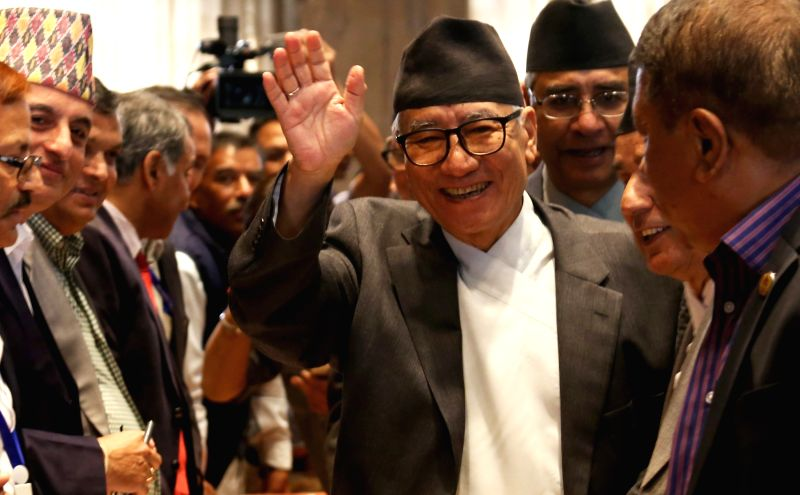 Nepali Congress leader Kul Bahadur Gurung (C) waves hands after filing his nomination for the election of President at Parliament in Kathmandu, Nepal, Oct. 27, ...