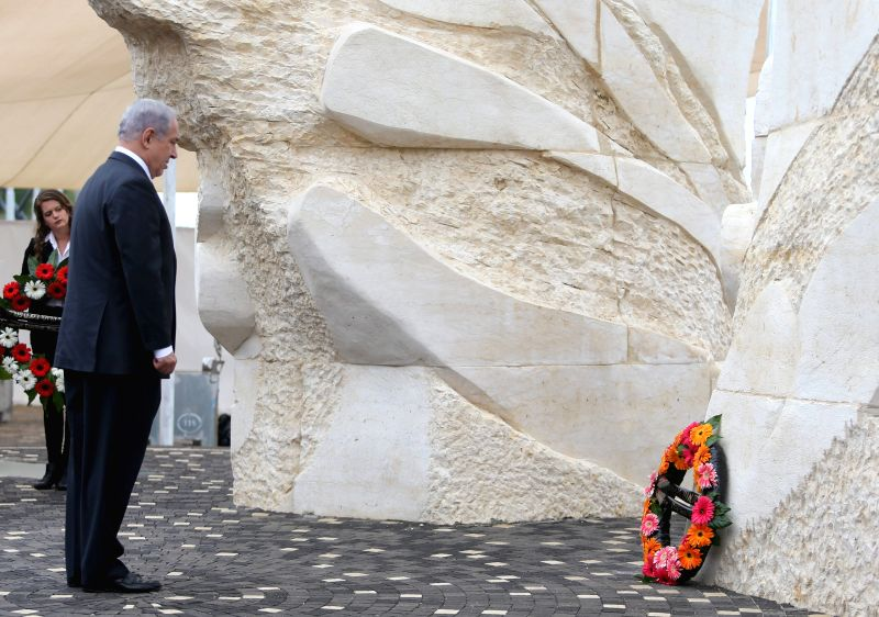 """NETANYA (ISRAEL), May 8, 2014 Photo: Israeli Prime Minister Benjamin Netanyahu (Front) mourns after laying a wreath at the """"Victory Monument"""" during a ceremony marking the ... - Benjamin Netanyahu"""