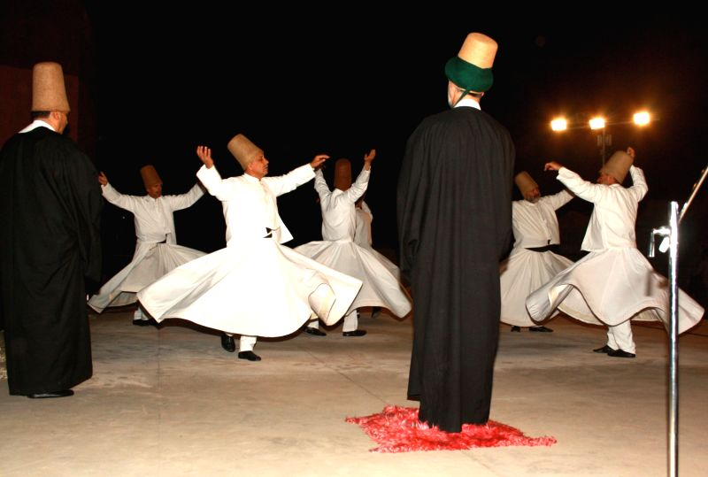 "New Delhi,30 Oct 2012-Performance by Whirling Dervishes from Turkey called ""Konya Turkish Tasawwuf Music Ensemble at Jamia Millia Islamia, in New Delhi on Tuesday-IANS Photo by Amlan ..."