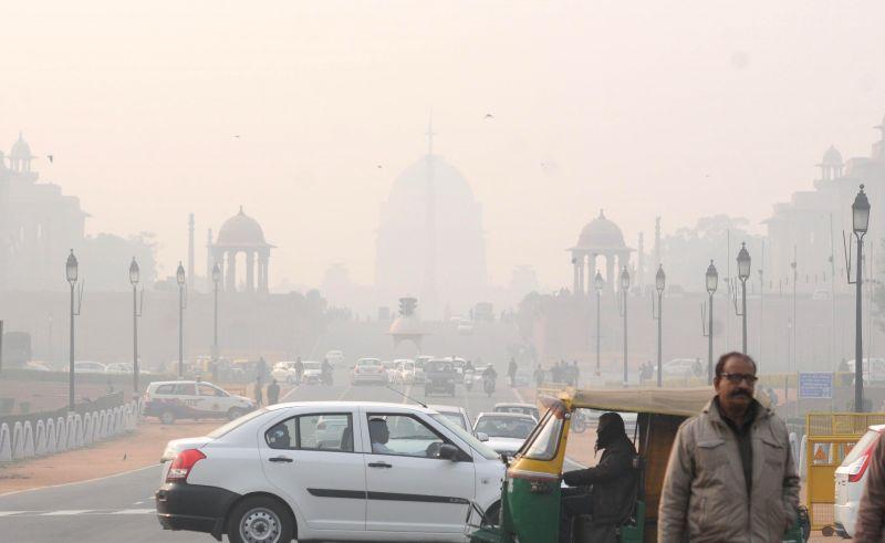 A blanket of fog covers the Rashtrapati Bhavan in New Delhi, on Dec 18, 2014.