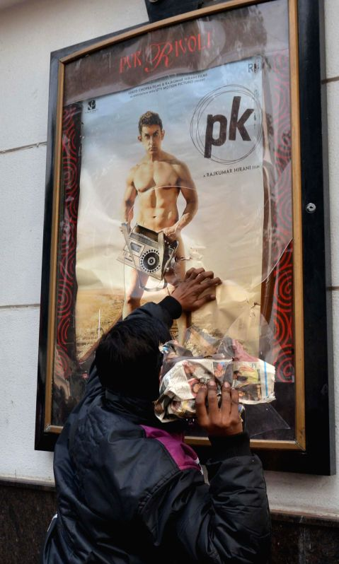 A broken poster frame  at a Delhi theatre screening Amir Khan starrer `PK`  in New Delhi, on Dec 28, 2014. Hindu Sena activists  staged a protest against the film at Connaught Place. - Khan
