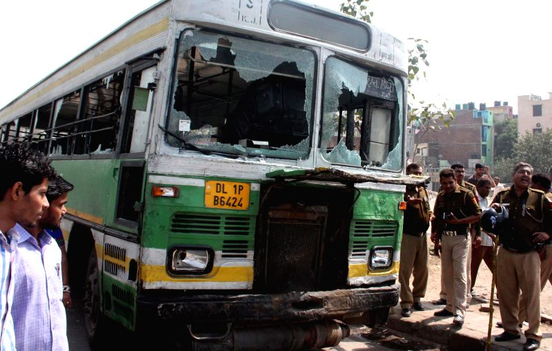 A bus that was damaged by an irate mob after a child was run over by a bus on Mehrauli Badarpur Road near Ambedkar Nagar, New Delhi on March 13, 2015.
