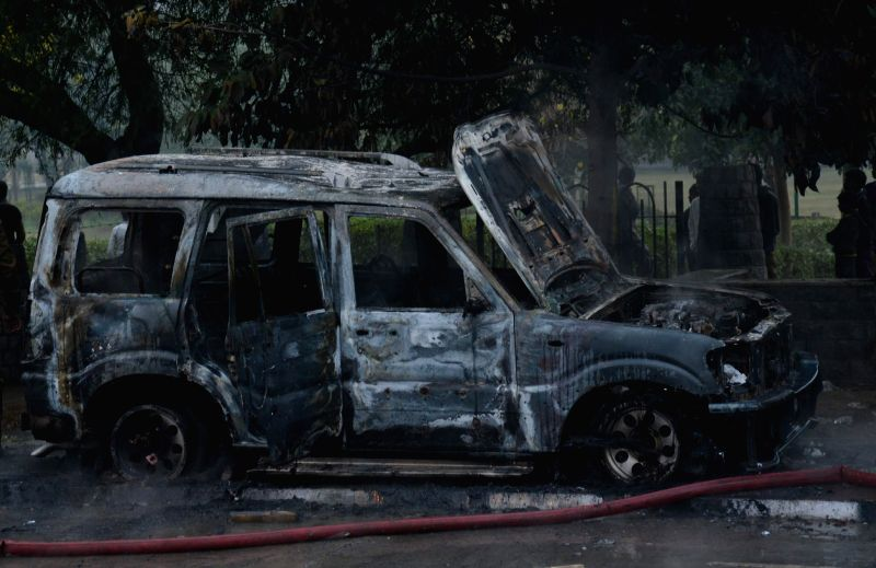 A charred vehicle seen after a clash between AAP and BJP workers following a debate show on a Hindi television channel in Tughlakabad area of south Delhi on Jan. 3, 2015.