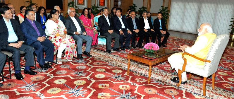 A delegation from Gujarati Association, Malaysia calls on the Prime Minister Narendra Modi, in New Delhi, on Feb 21, 2015. - Narendra Modi