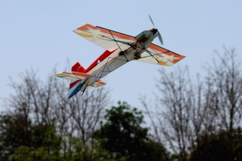 A flying model aircraft during the `Aero-modelling Competition` at IIT Delhi in New Delhi on April 11, 2015.