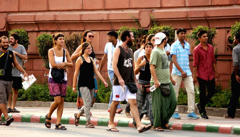 A group of foreigners going to attend the Yoga Day event to commemorate International Yoda Day at Rajpath in New Delhi on June 21, 2015.