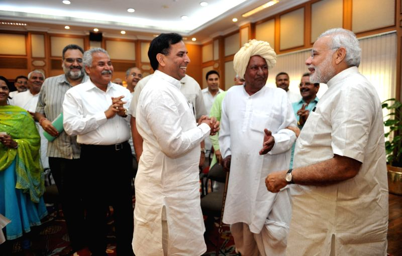 A Jat delegation meets Prime Minister Narendra Modi in New Delhi on March 26, 2015. - Narendra Modi