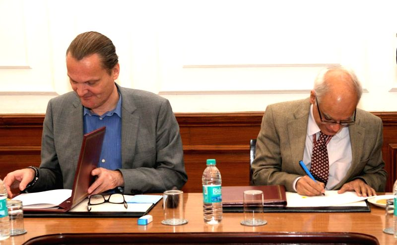 A legal document being signed between India and World Bank in respect of sustainable livelihood and adaptation to climate change programme, in New Delhi on Feb 13, 2015.