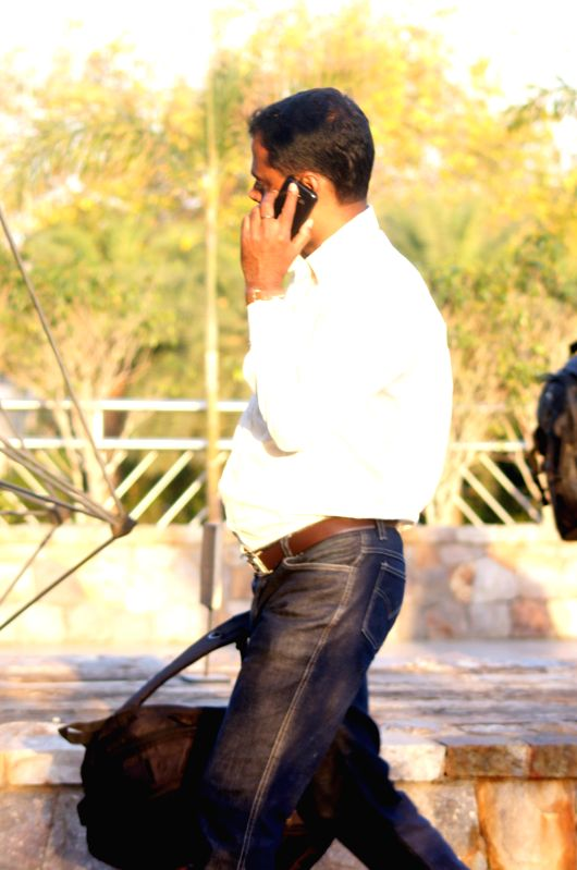 A man busy talking over his mobile phone.