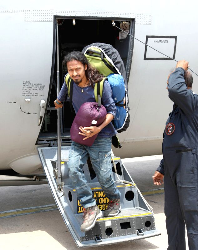 A man who was rescued from earthquake hit Nepal deboards an IAF Aircraft at Palam Air Force Station in New Delhi.