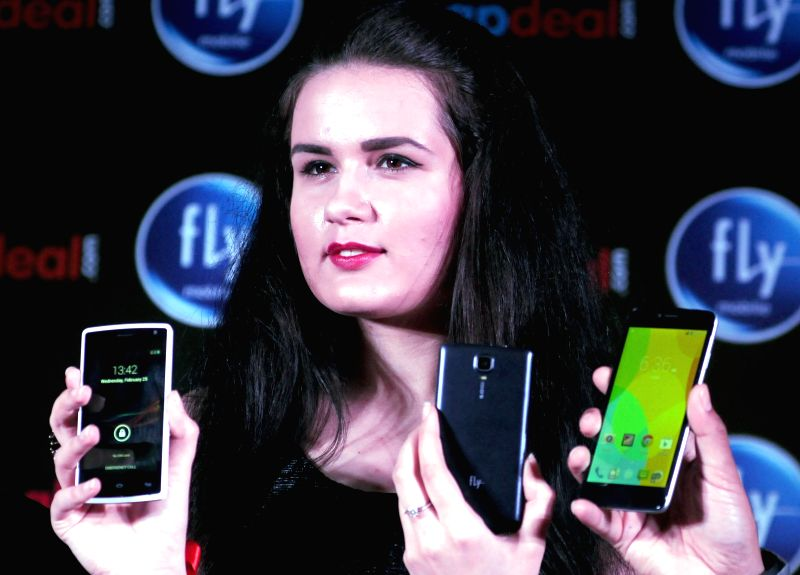 A model launches Fly smartphone in New Delhi, on Feb 25, 2015.