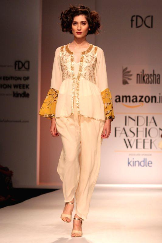 A model showcases fashion designer Nikasha Tawadey during Amazon India Fashion Week on March 25, 2015.