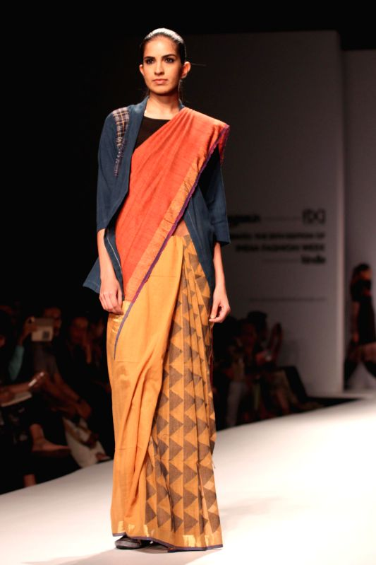 A model showcases fashion designer Paromita Banerjee`s creations during Amazon India Fashion Week in New Delhi, on March 27, 2015.