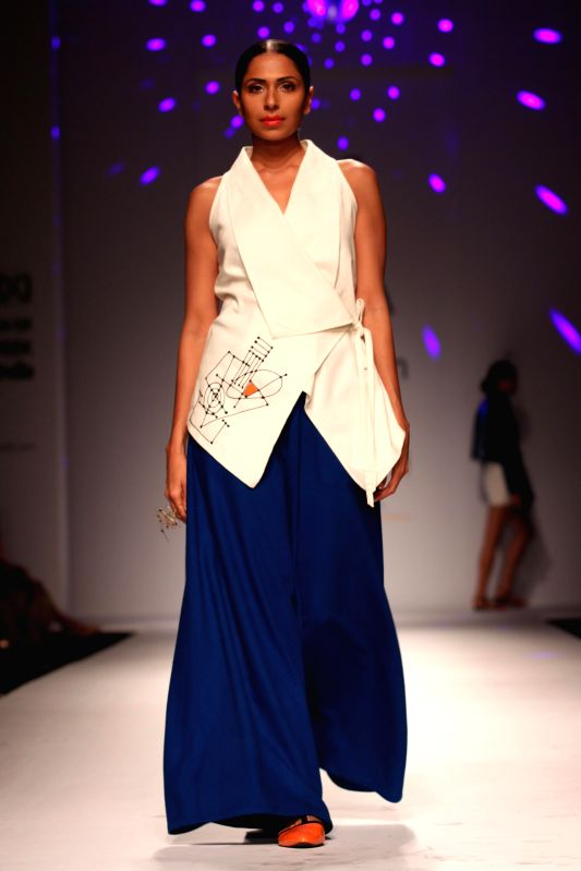 A model showcases fashion designer Poonam Bhagat`s creations during Amazon India Fashion Week in New Delhi, on March 28, 2015.