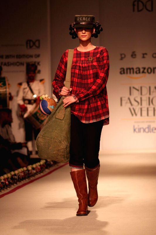 A model showcases fashion designer Aneeth Arora`s creations during Amazon India Fashion Week in New Delhi, on March 28, 2015.