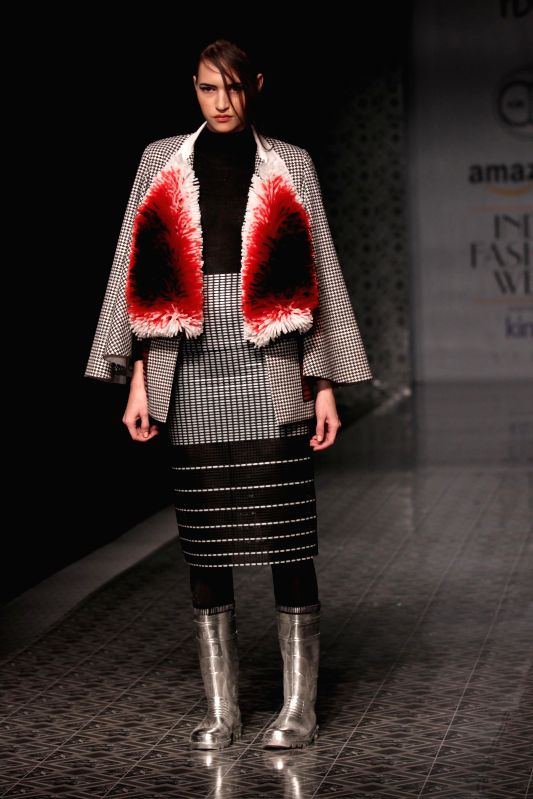 A model showcases fashion designer Amit Aggarwal`s creations during Amazon India Fashion Week in New Delhi, on March 26, 2015.