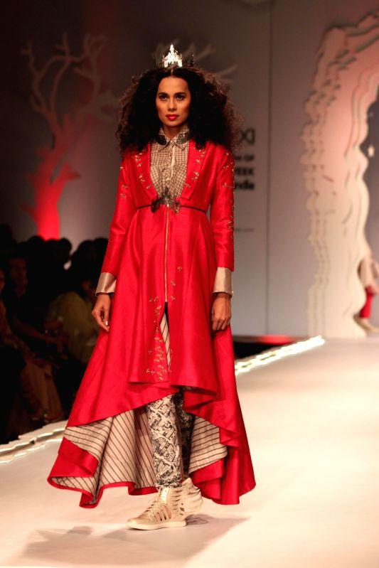 A model showcases fashion Designer Anju Modi, Amazon India Fashion Week in New Delhi, on March 25, 2015.