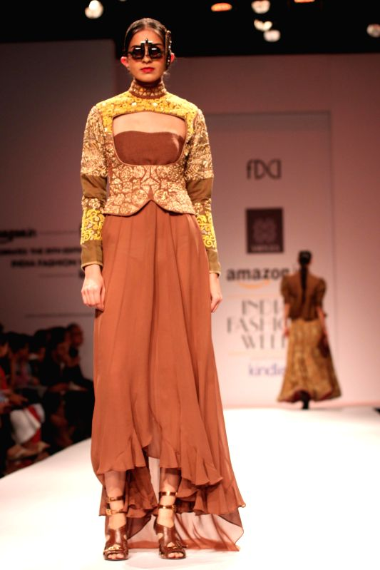 A model showcases fashion designer trio Ashish, Viral and Vikrant`s creations during Amazon India Fashion Week in New Delhi, on March 28, 2015.