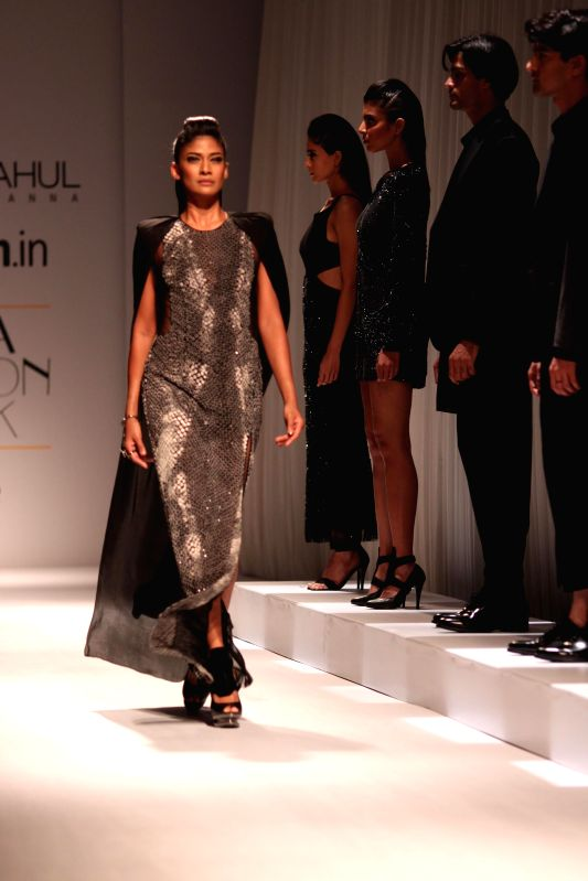 A model showcases fashion designers Rohit Gandhi and Rahul Khanna 's creations during Amazon India Fashion Week in New Delhi, on March 26, 2015.