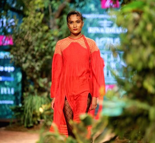 A model showcases the creation of fashion designer Rina Dhaka on the opening day of Lotus India Fashion Week in New Delhi(Image Source: IANS News)