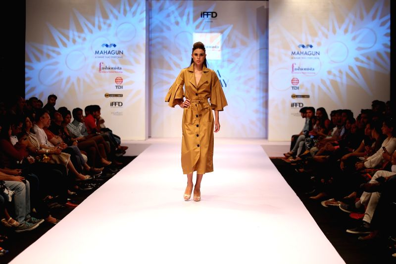 A model walks the ramp during India Runway Week in New Delhi, on April 12, 2015.